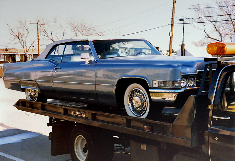 1969 Caddy on Flatbed front at Carefully-carried Cadillac convertible cargo at Lido Beach Boulevard., Lido Beach, Long Island, NY